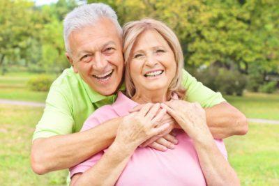 Healthy elderly couple enjoying their lovely dentures