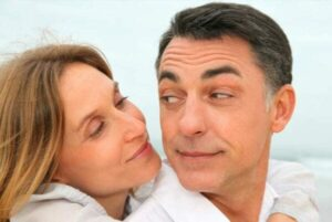 Close up portrait of loving couple enjoying time together after a routine dental check-up preventing gum disease