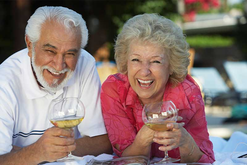 gum grafting patients laughing and enjoying wine