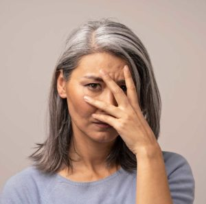 Santa Barbara Dental Patient Holding her face due to tooth pain