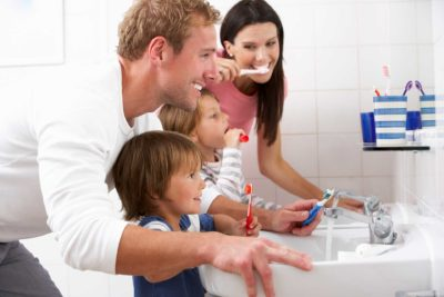 santa barbara family brushing teeth together