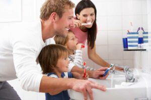 santa monica family brushing teeth in mirror