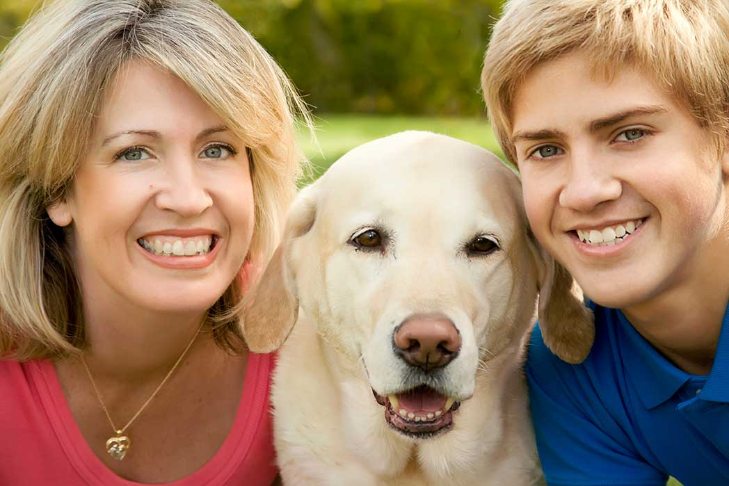 mother and son taking with photo with their dog